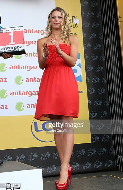 Marion Rousse French cyclist champion and girlfriend of Tony Gallopin participates at the trophy ceremony as hostess for Antargaz after stage...