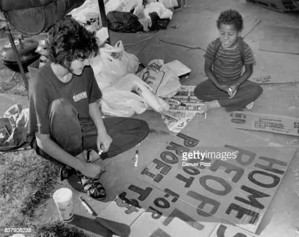 Marion St Kristen McLaughlin and Karl Speer make protest signs agantest HUD Credit The Denver Post