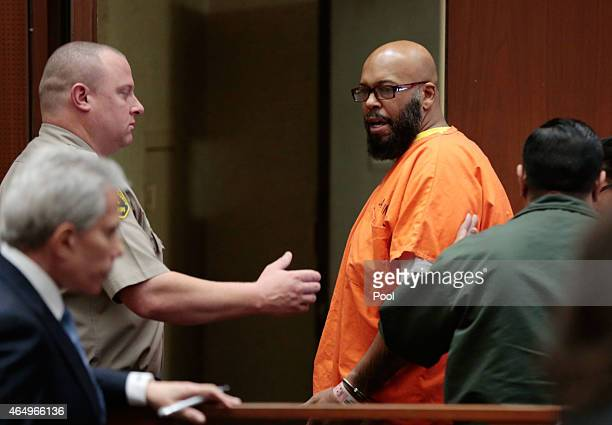 Marion 'Suge' Knight and his lawyer David E Kenner left front attend court at the Criminal Courts Building on March 2 2015 in Los Angeles California...