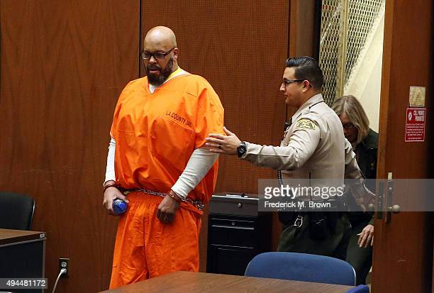Marion 'Suge' Knight enters Los Angeles Superior Court for his arraignment on October 27 2015 in Los Angeles California Knight and comedian Katt...