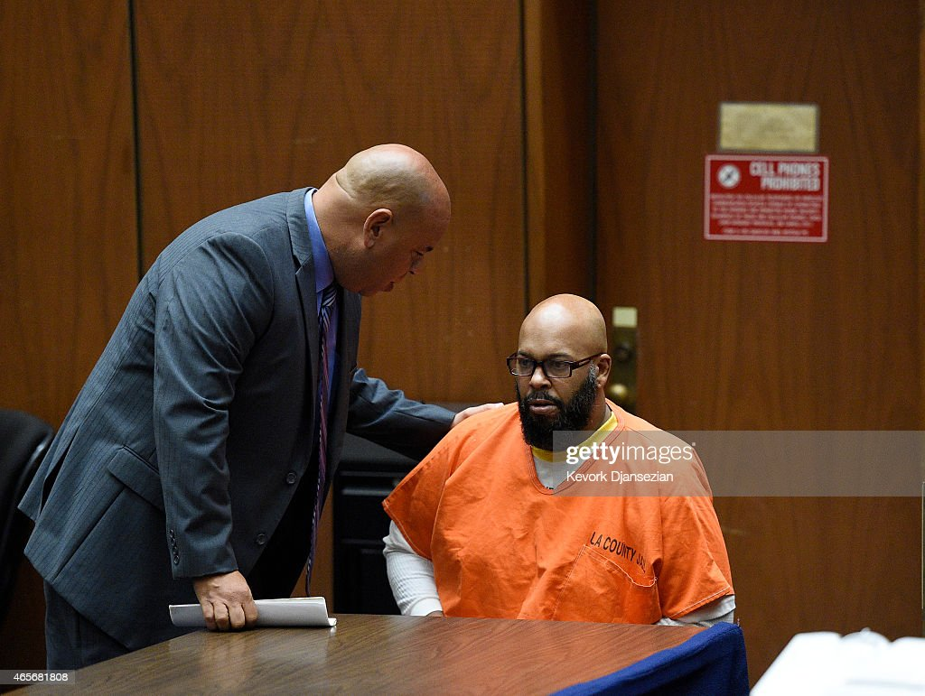 Marion 'Suge' Knight, right, appears for a haring with his lawyer Matthew P. Fletcher at the Clara Shortridge Foltz Criminal Justice Center March 9, 2015 in Los Angeles, California. The hearing was scheduled to determine if the two criminal cases against Knight, one for murder and attempted murder when Knight allegedly ran over two men in a Compton parking lot after an argument and another case involving an alleged robbery and criminal threats to a photographer in Beverly Hills, should be moved to the downtown Los Angeles courthouse.