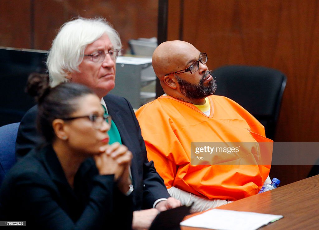 Marion 'Suge' Knight with his lawyers Thomas Mesereau and Shawn Holley makes a court appearance for assault and robbery charges at Criminal Courts...