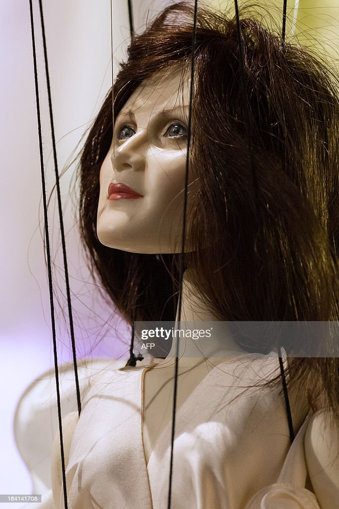 A marionette is seen during the Sao Paulo Fashion Week 2013 Fause Haten Summer collection presentation, in Sao Paulo, Brazil, on March 20, 2013. Real size collections are also showed after the show. AFP PHOTO / Yasuyoshi CHIBA