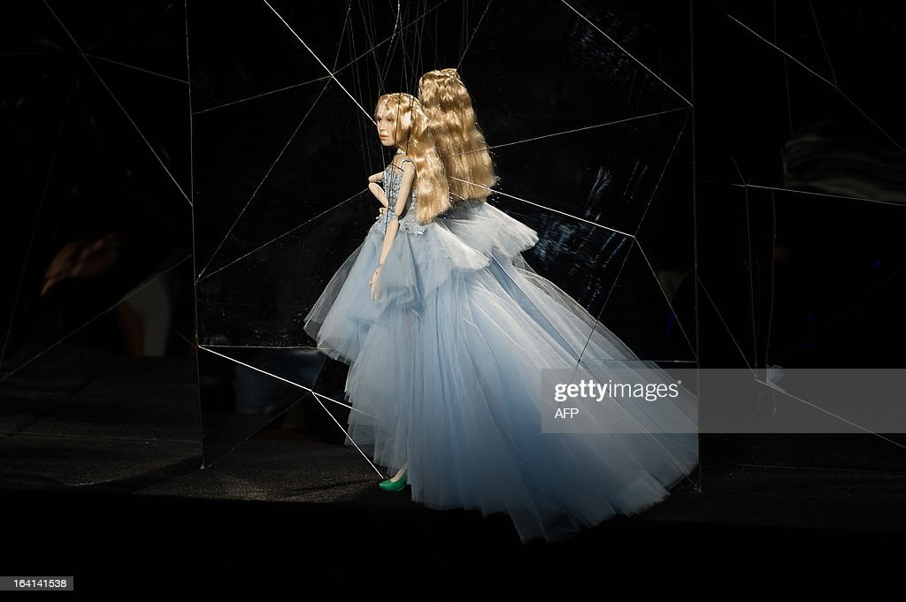 A marionette presents a creation by Fause Haten during the Sao Paulo Fashion Week 2013 Summer collections, in Sao Paulo, Brazil, on March 20, 2013. Real size collections are also showed after the show. AFP PHOTO / Yasuyoshi CHIBA