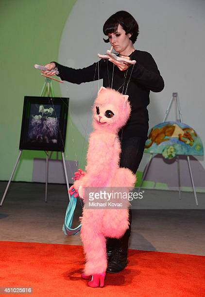 A marionette puppeteer performs onstage at the 'More Than a Cone' art auction and campaign launch benefiting Best Friends Animal Society in Los...