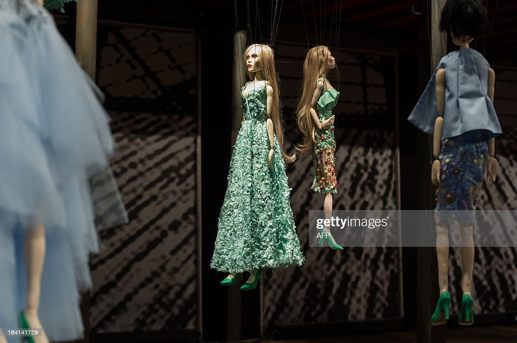 Marionettes are seen during the Sao Paulo Fashion Week 2013 Fause Haten Summer collection presentation, in Sao Paulo, Brazil, on March 20, 2013. Real size collections are also showed after the show. AFP PHOTO / Yasuyoshi CHIBA