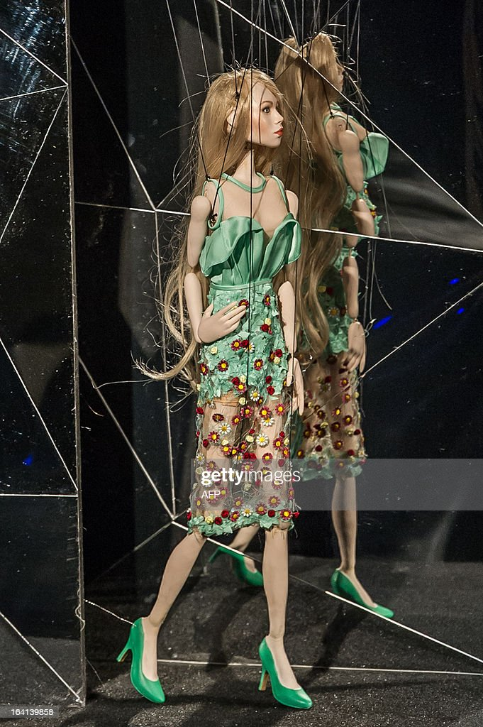 Marionettes present creations by Fause Haten during the Sao Paulo Fashion Week in Sao Paulo 2013 Summer collections, in Sao Paulo, Brazil, on March 20, 2013. Real size collections are also showed after the show. AFP PHOTO / Yasuyoshi CHIBA