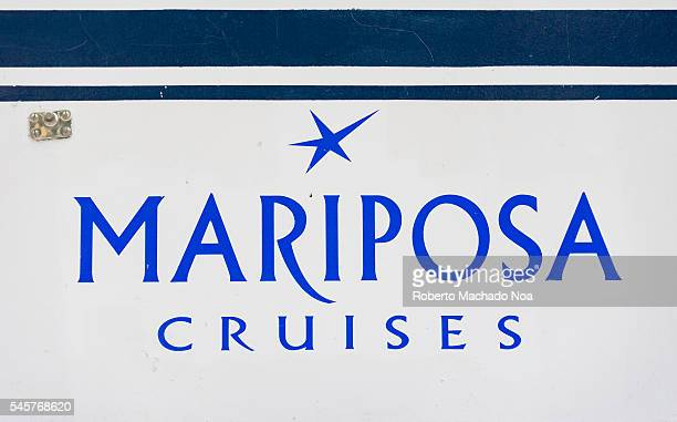 Mariposa Cruises company logo on the side of boat at Toronto's harbour
