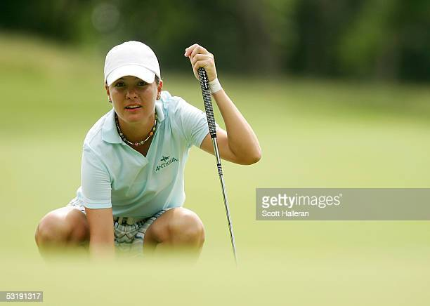Marisa Baena of Colombia lines up a putt on the 17th green during her match with Meena Lee of Korea during the finals of the HSBC World Match Play on...