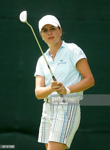 Marisa Baena of Colombia watches her eagle putt on the 14th hole during her match with Meena Lee of Korea during the finals of the HSBC World Match...