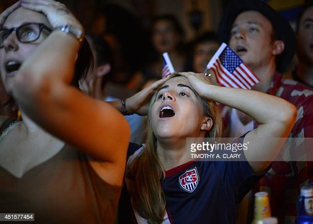 Marisa Marcellino reacts as she watches the final minute of the 2014 FIFA World Cup match between Belgium and USA from Jack Dempsey's Pub in New York...