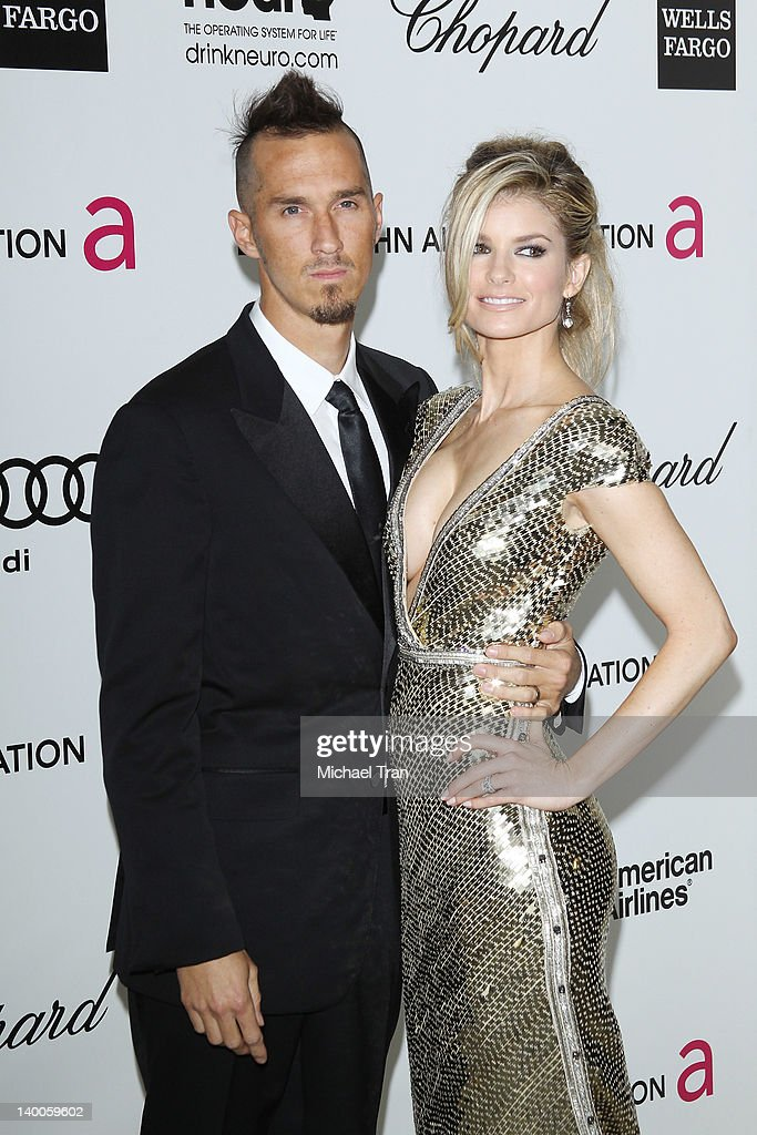 Marisa Miller and her husband Griffin Guess (L) arrives at the 20th Annual Elton John AIDS Foundation Academy Awards viewing party held across the street from the Pacific Design Center on February 26, 2012 in West Hollywood, California.