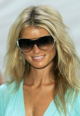 Marisa Miller in Vogue sunglasses during Sunglass Hut Swim Shows Miami Presented by LYCRA Welcome Reception at Raleigh Hotel in Miami Beach Florida...