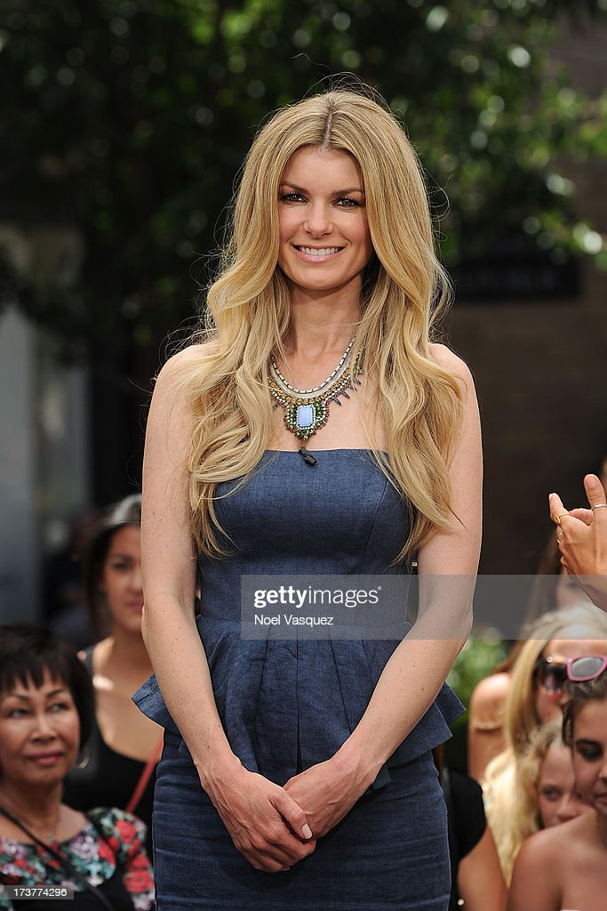 <a gi-track='captionPersonalityLinkClicked' href=/galleries/search?phrase=Marisa+Miller&family=editorial&specificpeople=224592 ng-click='$event.stopPropagation()'>Marisa Miller</a> visits 'Extra' at The Grove on July 17, 2013 in Los Angeles, California.