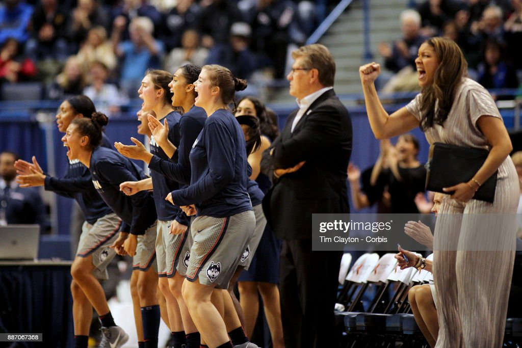 Marisa Moseley, assistant coach and head coach Geno Auriemma of the Connecticut Huskies and the team bench celebrate a basket during their come from behind win during the the UConn Huskies Vs Notre Dame, NCAA Women's Basketball game at the XL Center, Hartford, Connecticut. December 3, 2017