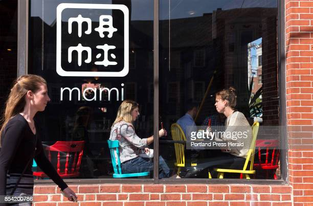 Marisa Polk center and Jeanette Baum right take a lunch break from their jobs at CIEE to eat at nearby Mami 339 Fore Street Portland