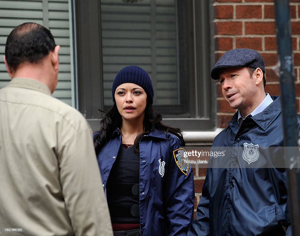 Marisa Ramirez and <a gi-track='captionPersonalityLinkClicked' href=/galleries/search?phrase=Donnie+Wahlberg&family=editorial&specificpeople=220537 ng-click='$event.stopPropagation()'>Donnie Wahlberg</a> filming on location for 'Blue Bloods' on March 15, 2013 in New York City.