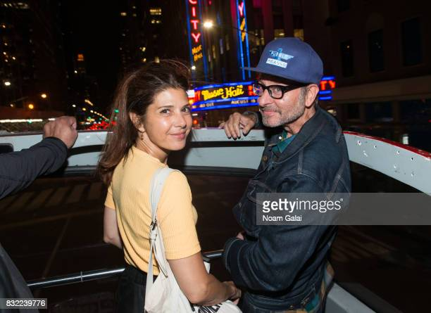 Marisa Tomei and Fisher Stevens join Michael Moore as he leads his Broadway audience to Trump Tower to protest President Donald Trump on August 15...
