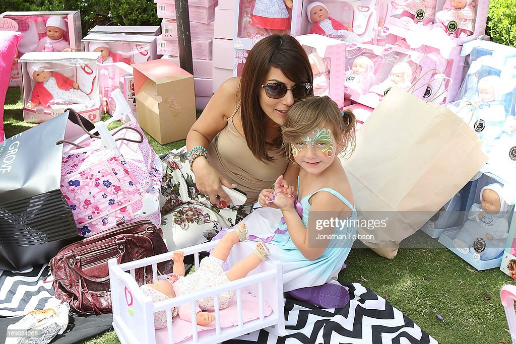 Marisol Nichols (L) and Rain India Lexton attend the Corolle Adopt a Doll Event at The Grove on May 18, 2013 in Los Angeles, California.