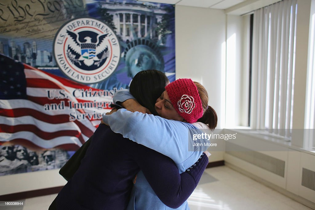Marisol Taveras (R), embraces her neice Adriana Taveras after Adriana received an official document at the U.S. Citizenship and Immigration Services (USCIS) district office on January 29, 2013 in New York City. Some 118,000 immigrants applied for citizenship in the New York City district in 2012.