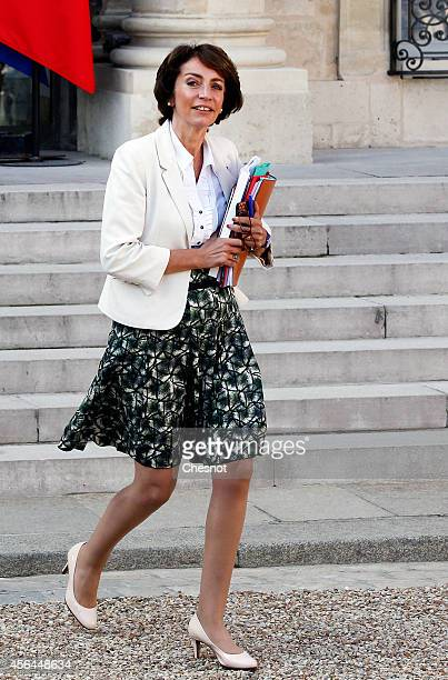Marisol Touraine French Minister of Social Affairs leaves the Elysee Palace after a weekly cabinet meeting on October 1 2014 in Paris France Francois...