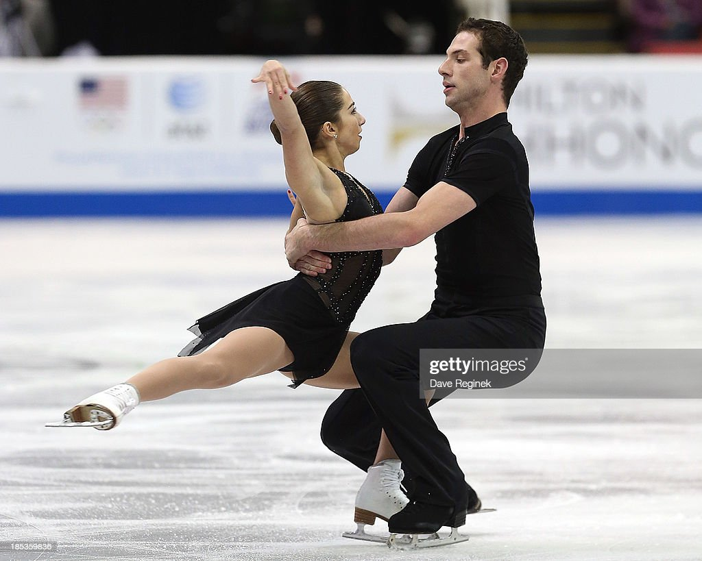 Marissa Castelli and Simaon Schnapir of the USA perform during the pairs short program of day two at Skate America at Joe Louis Arena on October 19, 2013 in Detroit, Michigan.