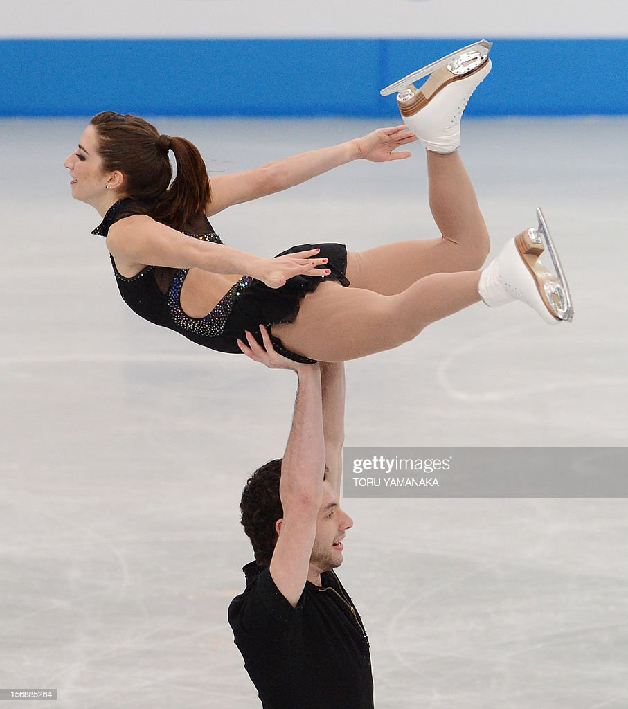 Marissa Castelli (top) and Simon Shnapir (bottom) of the US perform during the pairs' short program in the NHK Trophy, the last leg of the six-stage ISU figure skating Grand Prix series, in Rifu, northern Japan, on November 24, 2012. AFP PHOTO / Toru YAMANAKA