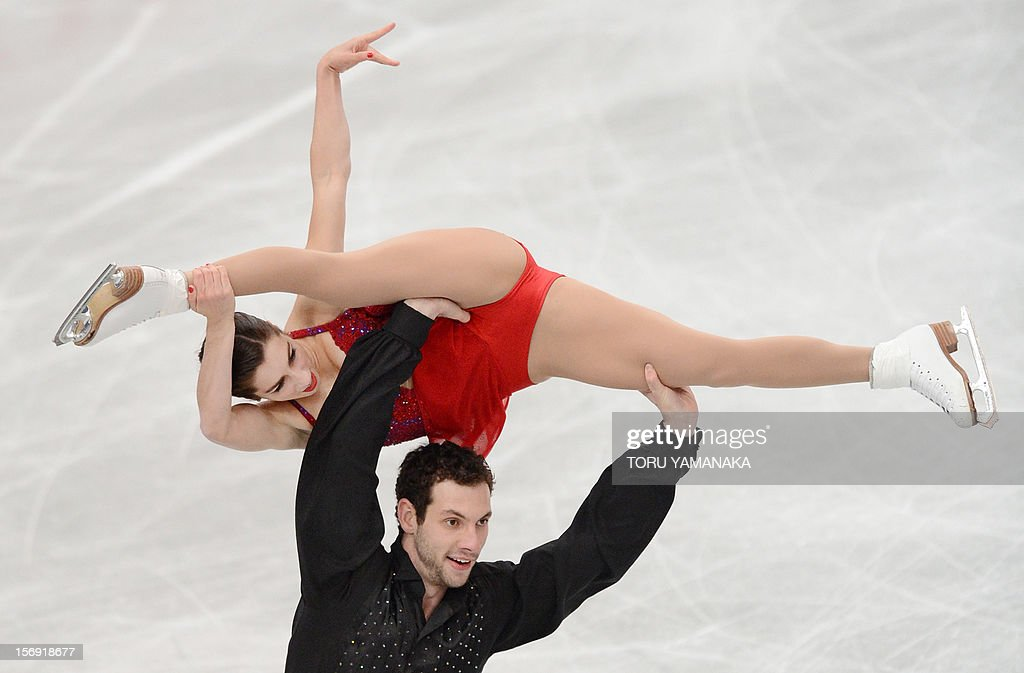 Marissa Castelli (top) and Simon Shnapir (bottom) of the US perform during the pairs' free skating in the NHK Trophy, the last leg of the six-stage ISU figure skating Grand Prix series, in Rifu, northern Japan, on November 25, 2012. The US pair won bronze medals in the competition. AFP PHOTO/Toru YAMANAKA