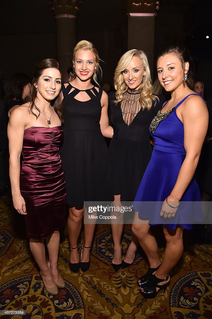 <a gi-track='captionPersonalityLinkClicked' href=/galleries/search?phrase=Marissa+Castelli&family=editorial&specificpeople=6702347 ng-click='$event.stopPropagation()'>Marissa Castelli</a>, Ashley Lober, <a gi-track='captionPersonalityLinkClicked' href=/galleries/search?phrase=Nastia+Liukin&family=editorial&specificpeople=241334 ng-click='$event.stopPropagation()'>Nastia Liukin</a> and Kim Jacob attend the Women's Sports Foundation's 35th Annual Salute to Women In Sports awards, a celebration and a fundraiser to ensure more girls and women have access to sports at Cipriani Wall Street on October 15, 2014 in New York City.