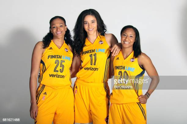 Marissa Coleman Natalie Achonwa and Briann January of the Indiana Fever poses for a portrait during Media Day at Bankers Life Fieldhouse on May 9...