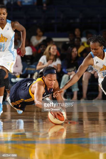 Marissa Coleman of the Indiana Fever dives for the ball against Epiphanny Prince of the Chicago Sky on July 22 2014 at the Allstate Arena in Rosemont...