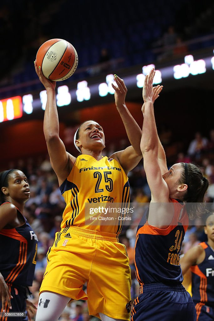 Marissa Coleman of the Indiana Fever shoots over Kelly Faris of the Connecticut Sun during the Indiana Fever Vs Connecticut Sun WNBA regular season...