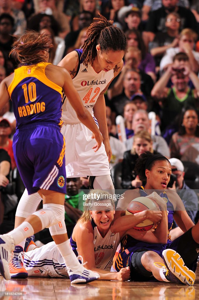 <a gi-track='captionPersonalityLinkClicked' href=/galleries/search?phrase=Marissa+Coleman&family=editorial&specificpeople=704307 ng-click='$event.stopPropagation()'>Marissa Coleman</a> #25 of the Los Angeles Sparks battles for a loose ball against <a gi-track='captionPersonalityLinkClicked' href=/galleries/search?phrase=Penny+Taylor&family=editorial&specificpeople=206985 ng-click='$event.stopPropagation()'>Penny Taylor</a> #13 of the Phoenix Mercury in Game 2 Round 1 of the 2013 WNBA Playoffs on September 13, 2013 at U.S. Airways Center in Phoenix, Arizona.