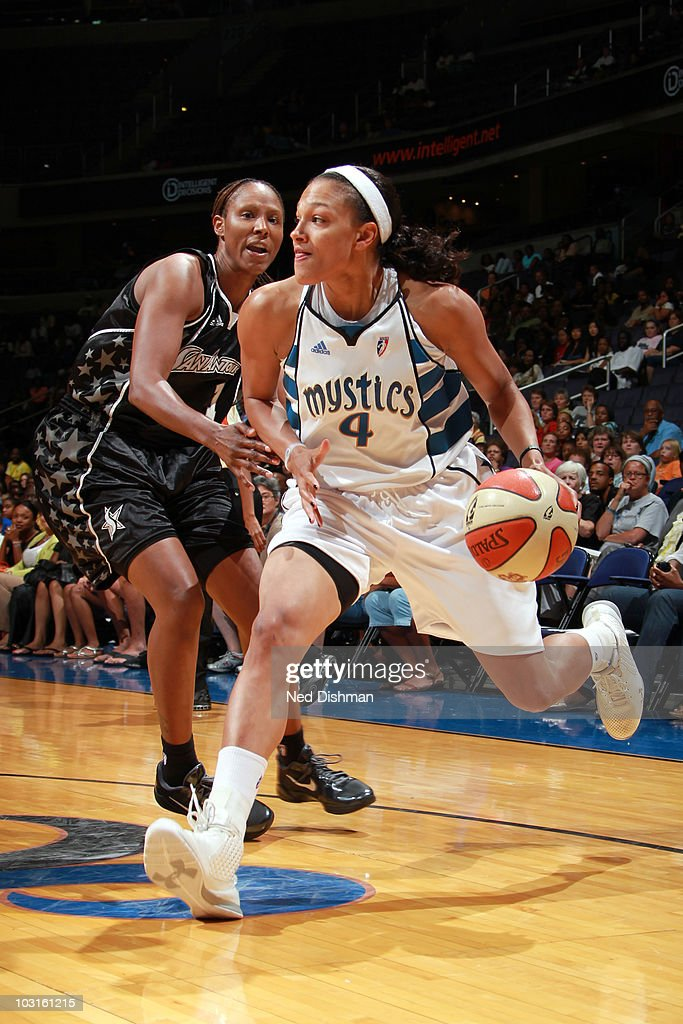 Marissa Coleman of the Washington Mystics drives against Chamique Holdsclaw of the San Antonio Silver Stars at the Verizon Center on July 29 2010 in...