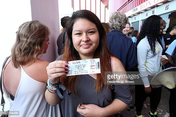 Marissa Gomez displays her ticket to attend the 5 Seconds of Summer concert at The Forum on July 26 2014 in Inglewood California
