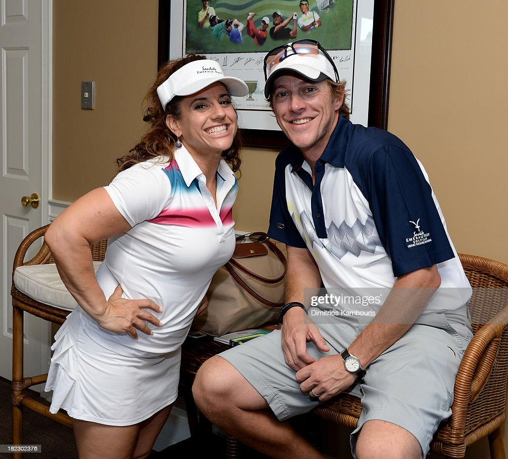 Marissa Jaret Winokur (L) and Kevin Rahm attend the Golf Clinic with Greg Norman and Golf Tournament during Day Three of the Sandals Emerald Bay Celebrity Getaway And Golf Weekend on September 29, 2013 at Sandals Emerald Bay in Great Exuma, Bahamas.