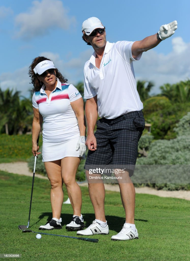 Marissa Jaret Winokur (L) and Slade Smiley attend the Golf Clinic with Greg Norman and Golf Tournament during Day Three of the Sandals Emerald Bay Celebrity Getaway And Golf Weekend on September 29, 2013 at Sandals Emerald Bay in Great Exuma, Bahamas.