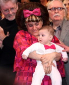 Marissa Jaret Winokur as 'Tracy Turnblad' and son Zev Isaac Miller during the final curtain call at the 'Hairspray' closing night on Broadway at The...