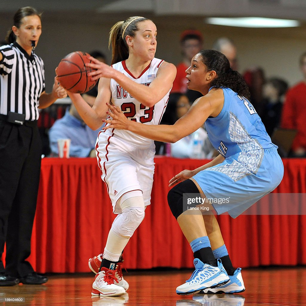 Marissa Kastanek #23 of the North Carolina State Wolfpack controls the ball against Krista Gross #21 of the North Carolina Tar Heels at Reynolds Coliseum on January 10, 2013 in Raleigh, North Carolina.