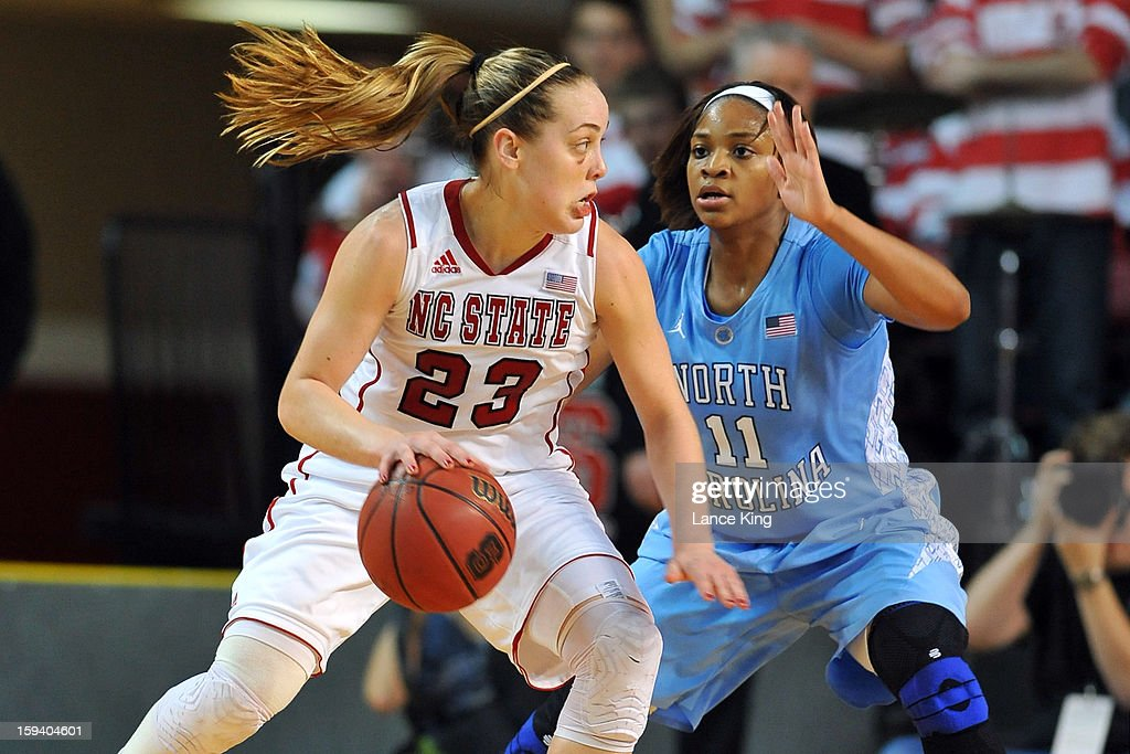 Marissa Kastanek #23 of the North Carolina State Wolfpack dribbles against Brittany Rountree #11 of the North Carolina Tar Heels at Reynolds Coliseum on January 10, 2013 in Raleigh, North Carolina.