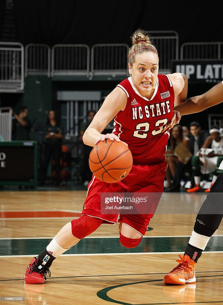 Marissa Kastanek #23 of the North Carolina State Wolfpack dribbles to the basket against the Miami Hurricanes on December 20, 2012 at the BankUnited Center in Coral Gables, Florida. The Hurricanes defeated the Wolfpack 79-53.