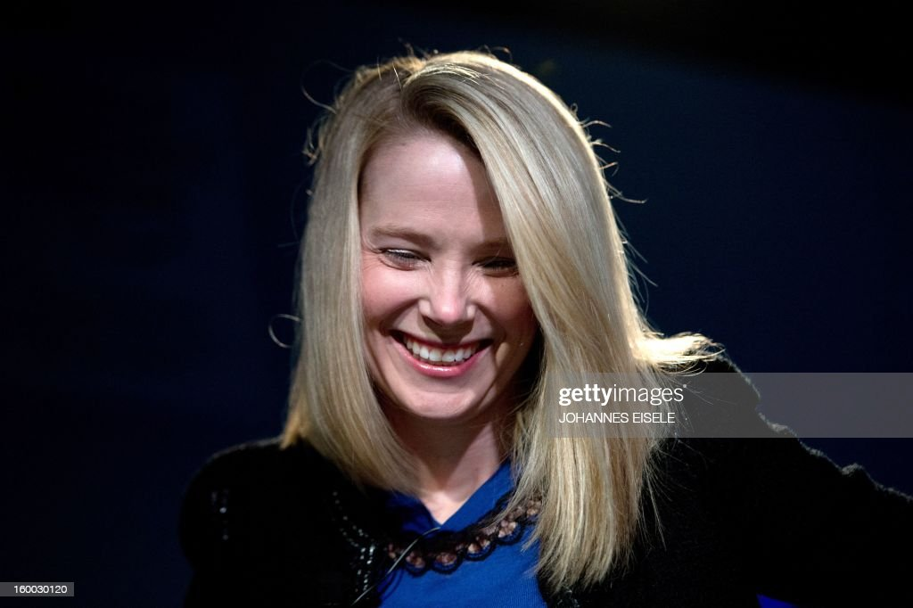 Marissa Mayer, CEO of Yahoo!, smiles during a session of the World Economic Forum 2013 Annual Meeting on January 25, 2013 at the Swiss resort of Davos. The World Economic Forum (WEF) is taking place from January 23 to 27. AFP PHOTO / JOHANNES EISELE