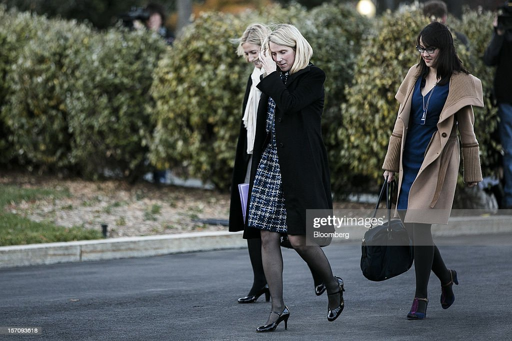 Marissa Mayer, chief executive officer of Yahoo! Inc., center, arrives at the White House for a meeting with U.S. President Barack Obama in Washington, D.C., U.S., on Wednesday, Nov. 28, 2012. Business executives pressing for a solution to the so-called fiscal cliff made their case at the White House and the Capitol a day after Senate Majority Leader Harry Reid lamented the lack of progress toward a deal. Photographer: T.J. Kirkpatrick/Bloomberg via Getty Images