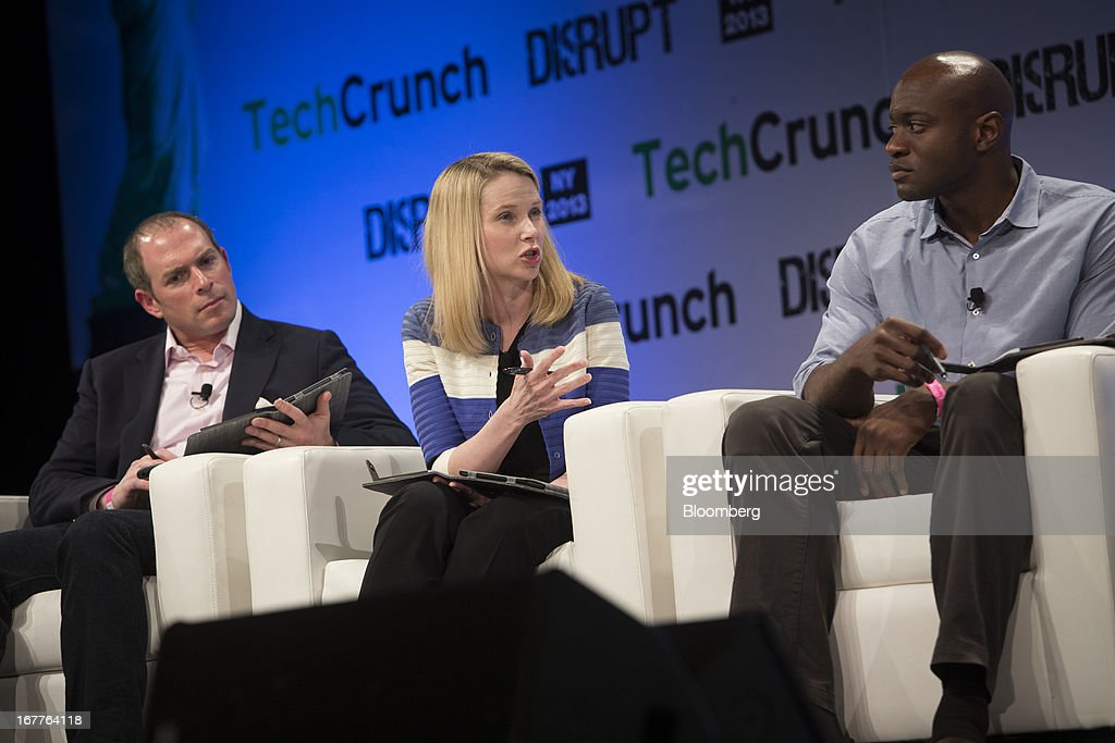Marissa Mayer, chief executive officer of Yahoo! Inc., center, speaks during the TechCrunch Disrupt NYC 2013 conference in New York, U.S., on Monday, April 29, 2013. The event features leaders from various technology fields and includes a competition for the best new startup company. Photographer: Scott Eells/Bloomberg via Getty Images