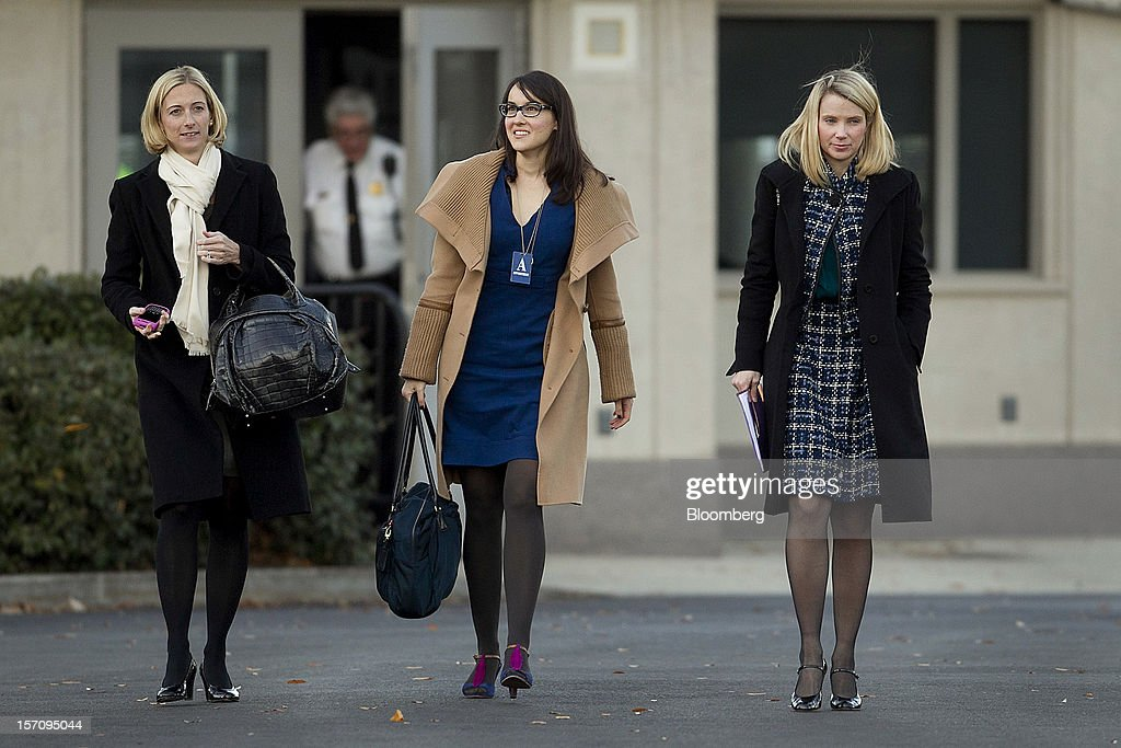 Marissa Mayer, chief executive officer of Yahoo! Inc., right, arrives to the White House in Washington, D.C., U.S., on Wednesday, Nov. 28, 2012. U.S. President Barack Obama reached out to chief executives and middle-income taxpayers, imploring them to press Congress to avoid the fiscal cliff as he said he wants to get a deal 'done before Christmas.' Photographer: Andrew Harrer/Bloomberg via Getty Images