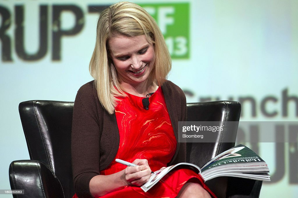 <a gi-track='captionPersonalityLinkClicked' href=/galleries/search?phrase=Marissa+Mayer&family=editorial&specificpeople=5577875 ng-click='$event.stopPropagation()'>Marissa Mayer</a>, chief executive officer of Yahoo! Inc., signs a copy of the Vogue Magazine that she appears in at the TechCrunch Disrupt SF 2013 conference in San Francisco, California, U.S., on Wednesday, Sept. 11, 2013. Yahoo! Mayer said the Web portal has surpassed 800 million active monthly users, a 20 percent increase since she joined the company in July 2012. Photographer: David Paul Morris/Bloomberg via Getty Images