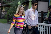 Marissa Mayer chief executive officer of Yahoo Inc walks with her husband Zachary 'Zach' Bogue comanaging partner at Data Collective as they arrive...