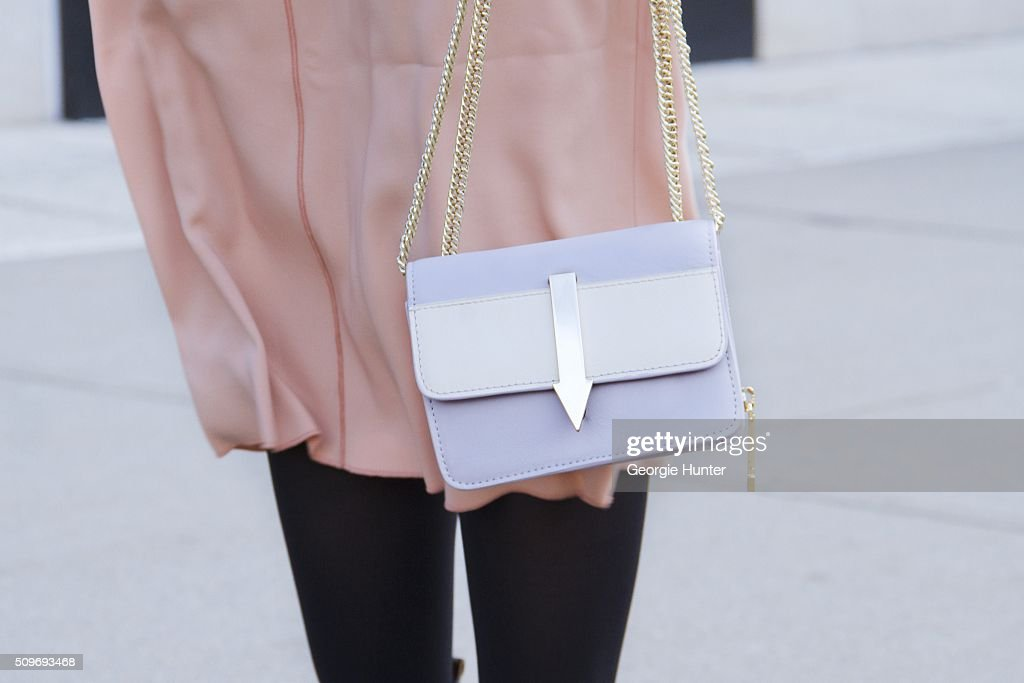 Marissa Smith seen at Skylight Clarkson Sq. outside the Erin Fetherston show wearing Rhoi peach dress and Karen Walker bag during New York Fashion Week: Women's Fall/Winter 2016 on February 11, 2016 in New York City.