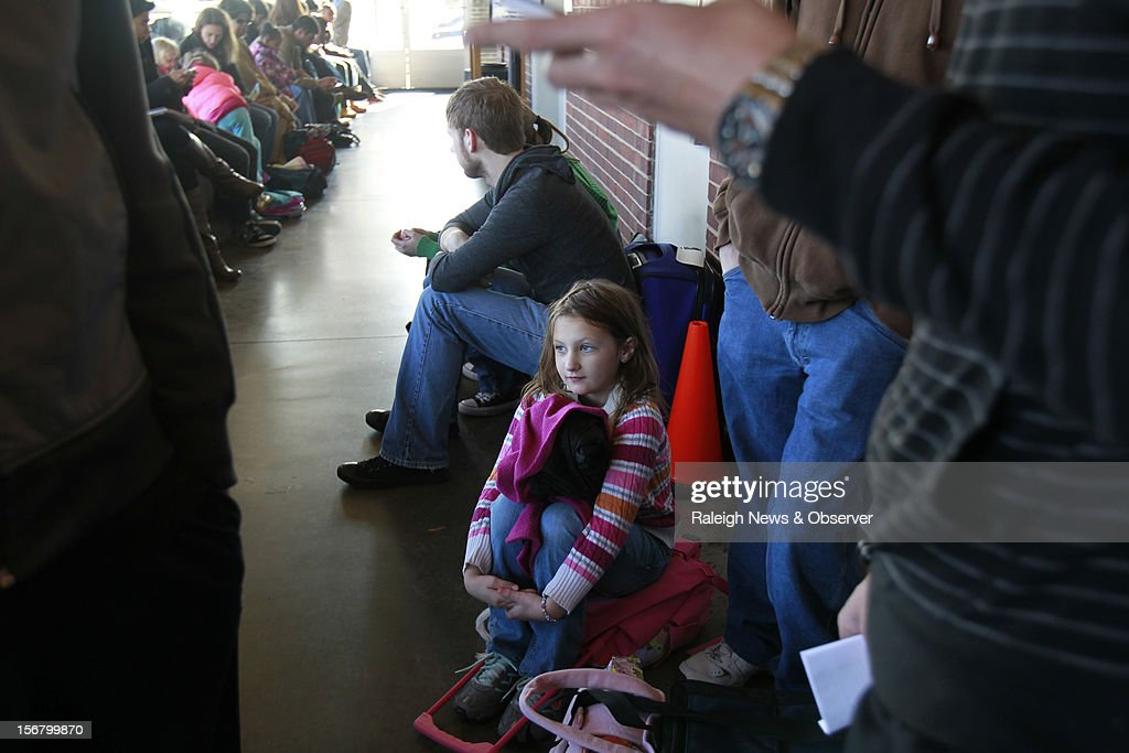 Marissa Zendzan, 7, of Raleigh, North Carolina, waits for an Amtrak train with her father Wednesday, November 21, 2012. The Amtrak station in Raleigh was congested with travelers who were setting out on the annual Thanksgiving migration. The pair was headed to Maryland to see their family members.