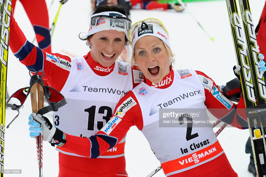 Marit Bjoergen and Therese Johaug of Norway takes 1st and 2nd place during the FIS Cross-Country World Cup Women's Mass Start on January 19, 2013 in La Clusaz, France.